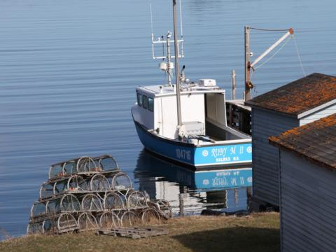 Lobster boat at dock on Sober Island, NS