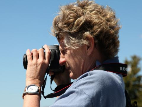 Woman takes a photograph