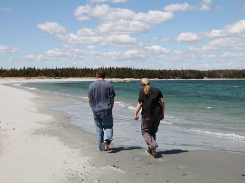 Couple walks on the beach, Eastern Shore NS